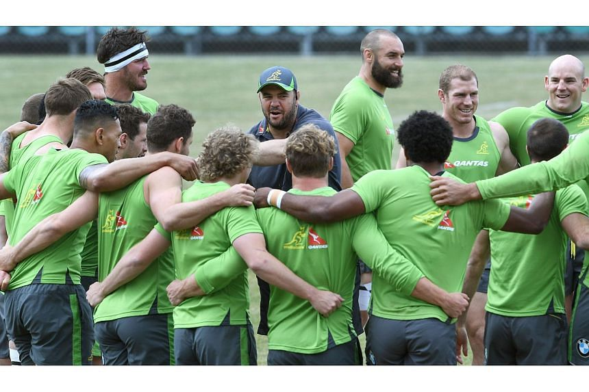 Australian Wallabies rugby coach Michael Cheika (centre) speaks to his players during a training session, in Sydney on Oct 20, 2016.