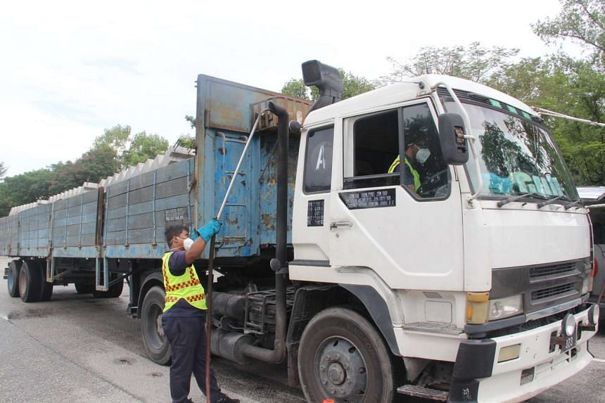 NEA conducting smoke emission tests on vehicles that were stopped for emitting smoke.