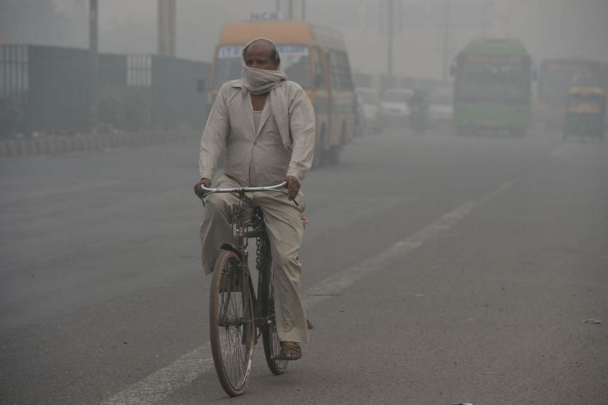 Smog and air pollution blurring the skyline in New Delhi yesterday. Coal-fired power generation contributes to the air pollution that makes India home to what the World Health Organisation has determined are 11 of the top 20 cities on the planet with the