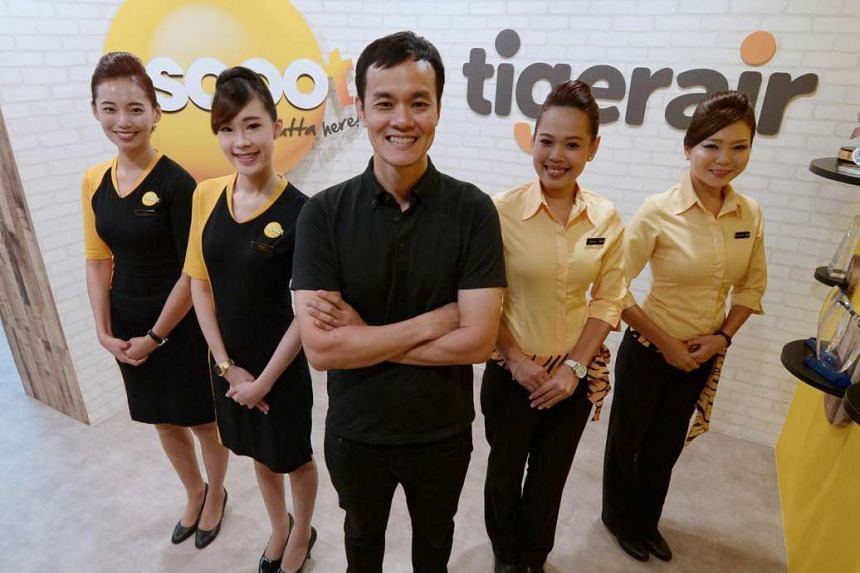 Mr Lee Lik Hsin (middle), chief executive of Budget Aviation Holdings which operates Scoot and Tigerair, with cabin crew at the company's office on Aug 16.