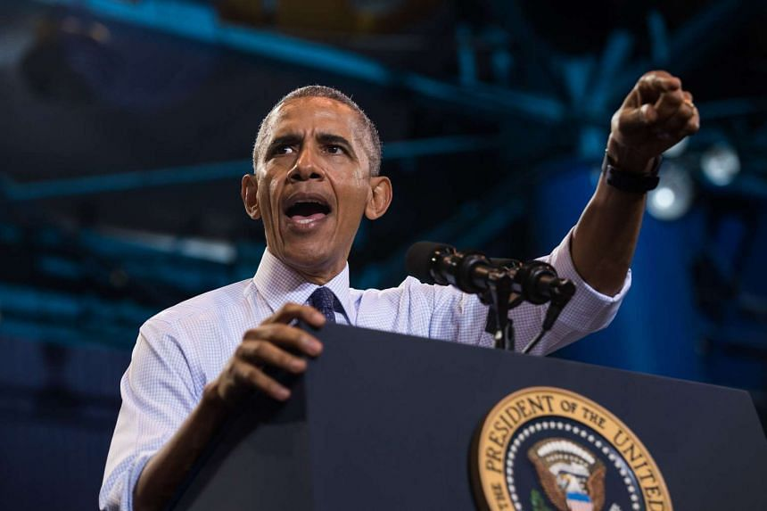 US President Barack Obama speaking at a rally for Democratic presidential nominee Hillary Clinton at the University of North Florida, on Nov 3, 2016.
