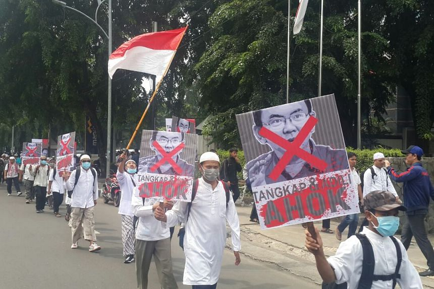 Front Pembela Islam members marching towards Istiqlal mosque in Jakarta.