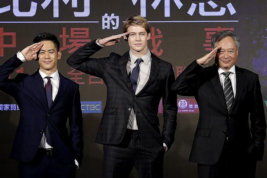 Lee Ang (left) with cast members of Billy Lynn's Long Halftime Walk, his son Mason Lee (far left) and Joe Alwyn (centre).