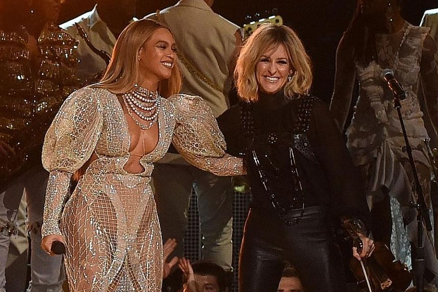 Beyonce (above left) performing with Martie Maguire of Dixie Chicks.