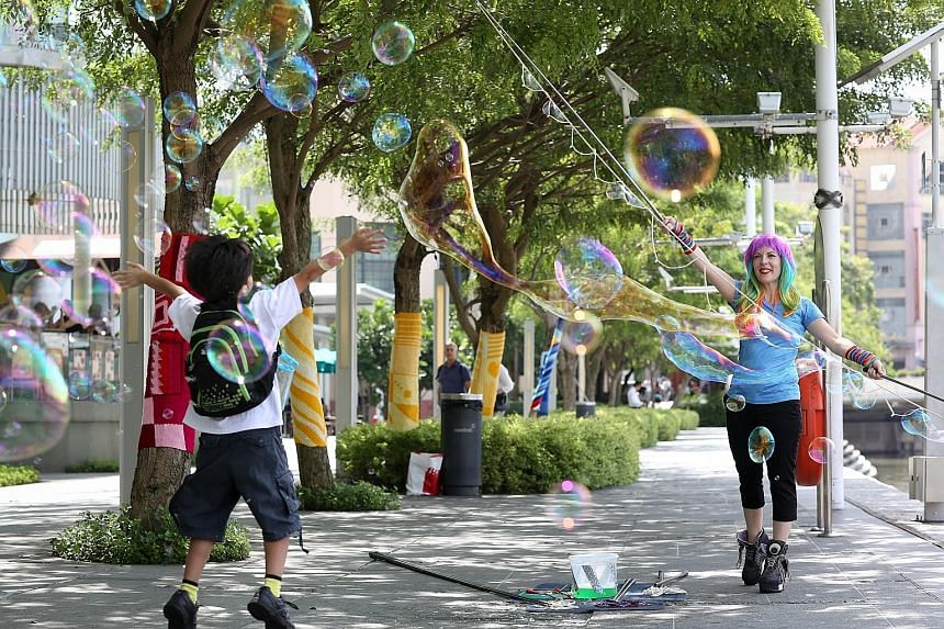 """""""Bubbles hate air- conditioning and love humidity,"""" says Ms Caroline Cornelius- Jones, aka CJ the Bubble Girl. The wind and sun are not kind to bubbles either. Tomorrow evening, she will create bubbles in all shapes and sizes at the Singapore River F"""