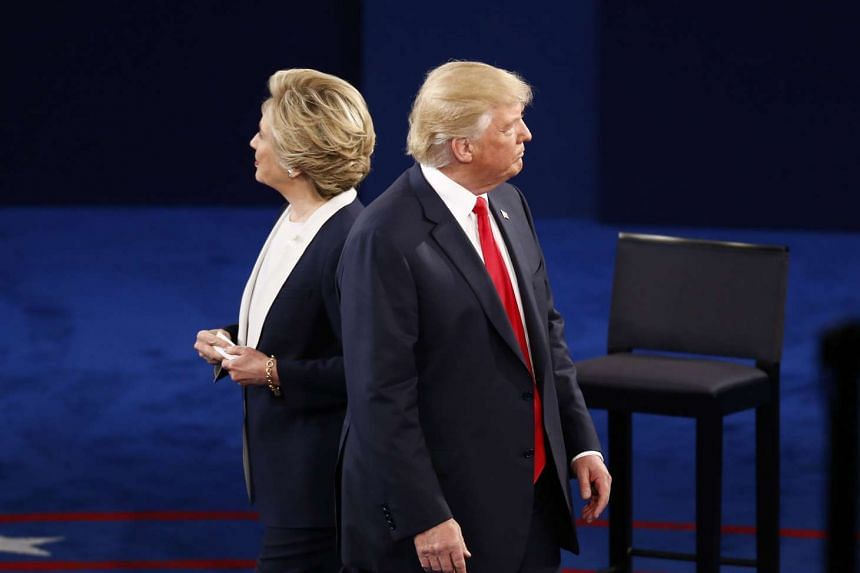 Hillary Clinton and Donald Trump at the second US presidential debate at Washington University in St. Louis, Missouri, on Oct 9, 2016.