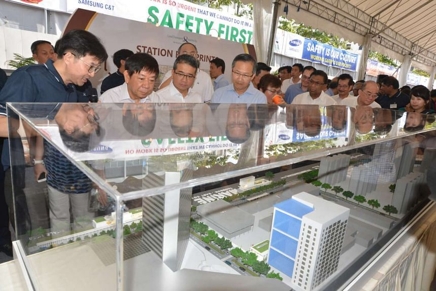 Minister for Transport Khaw Boon Wan (second from left) looking at the model of the Marine Parade MRT Station during the ground breaking ceremony of the Thomson-East Coast Line on July 21, 2016.