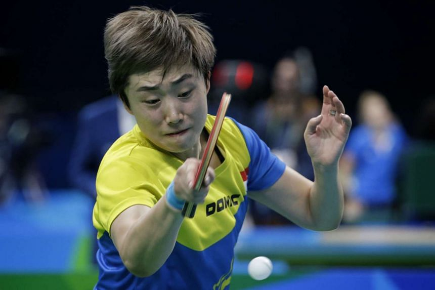 Feng Tianwei in action during the Rio 2016 Olympic Games table tennis women's team round 1 against Egypt in Rio de Janeiro, Brazil, on Aug 12, 2016.