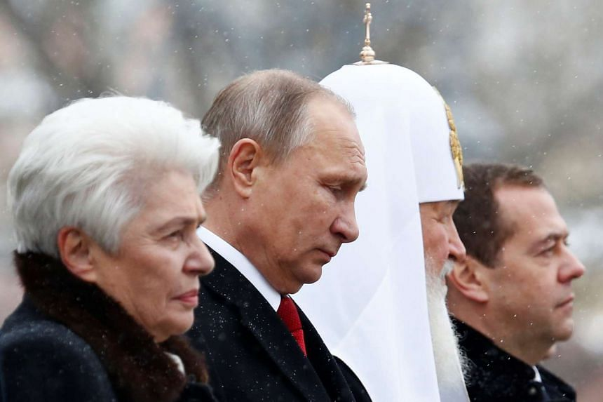 Russian President Vladimir Putin (second from left) attends a ceremony to unveil a monument of grand prince Vladimir I on National Unity Day in Moscow on Nov 4, 2016.