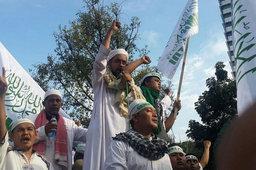 Islamic Defenders Front (FPI) leaders take turns to give speeches outside the City Hall in Jakarta on Nov 4, 2016.