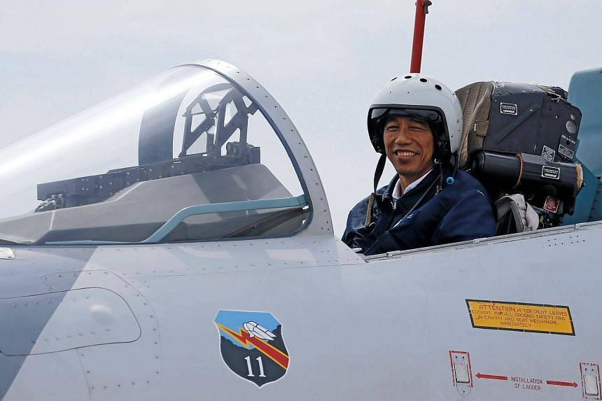 Indonesia's President Joko Widodo sits in the cockpit of a Sukhoi fighter jet while attending a military exercise at Ranai military airbase in Natuna Island, Riau Islands province, Indonesia on Oct 6, 2016.