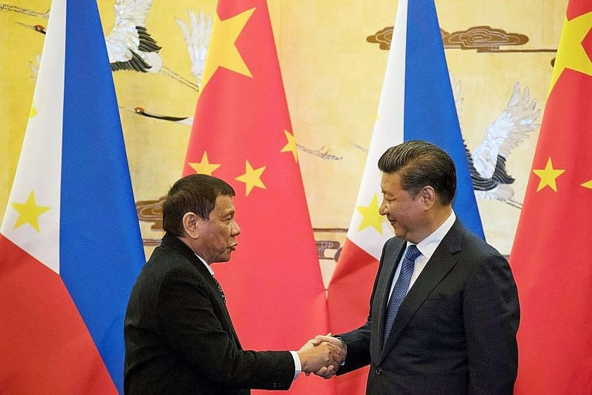 Philippine President Rodrigo Duterte (far left) with Chinese President Xi Jinping during his visit to China last month. China has dished out billions of dollars worth of investments and loans during the recent visits of several leaders from Asean, in
