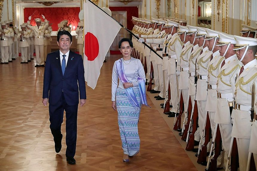 Japanese Prime Minister Shinzo Abe with Myanmar State Counsellor Aung San Suu Kyi in Tokyo on Wednesday. Mr Abe has pledged $10.7 billion in aid, loans and investments in Myanmar over five years.