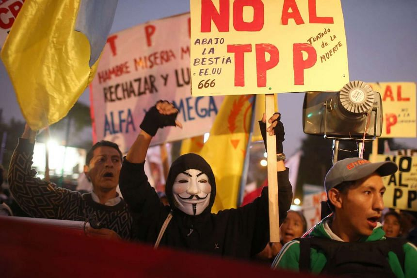 Members of social and civil organizations march to protest against the Trans-Pacific Partnership (TPP) Agreement in Lima, Peru on Nov 4, 2016.