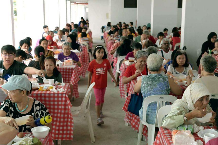 Marsiling residents having breakfast together at Marsiling Lane on Nov 6, 2016.