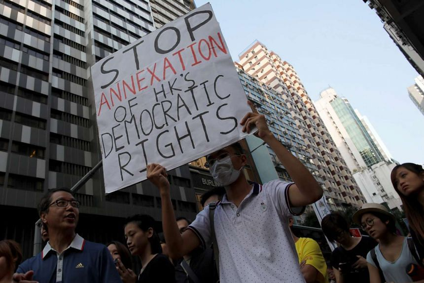 Demonstrators protest against what they call Beijing's interference over local politics and the rule of law in Hong Kong on Nov 6, 2016.
