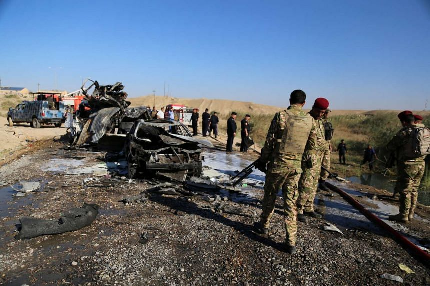 Iraqi security forces inspecting the site of a blast where a suicide bomber detonated an ambulance laden with explosives in Tikrit, Iraq, on Nov 6, 2016.