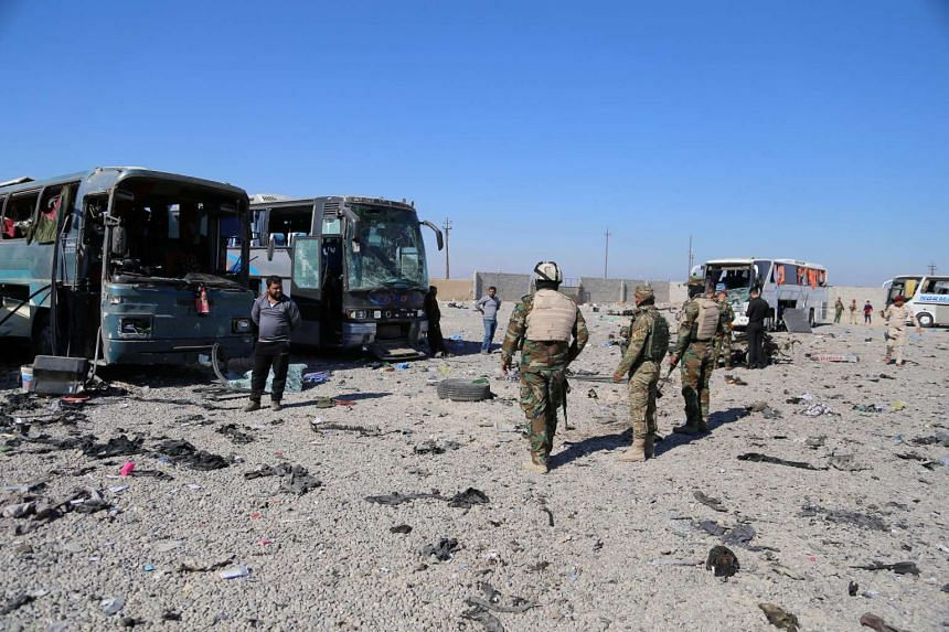 Iraqi soldiers inspecting the site of a suicide bombing in Samarra, north of Baghdad, on Nov 6, 2016.