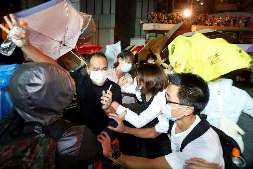 Protesters clashing with police officers during a demonstration in Hong Kong on Nov 6, 2016.