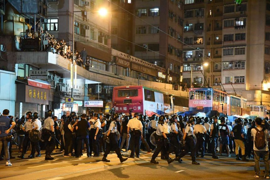 Police officers forming a human barricade while facing off against protesters during a demonstration in Hong Kong, on Nov 6, 2016.