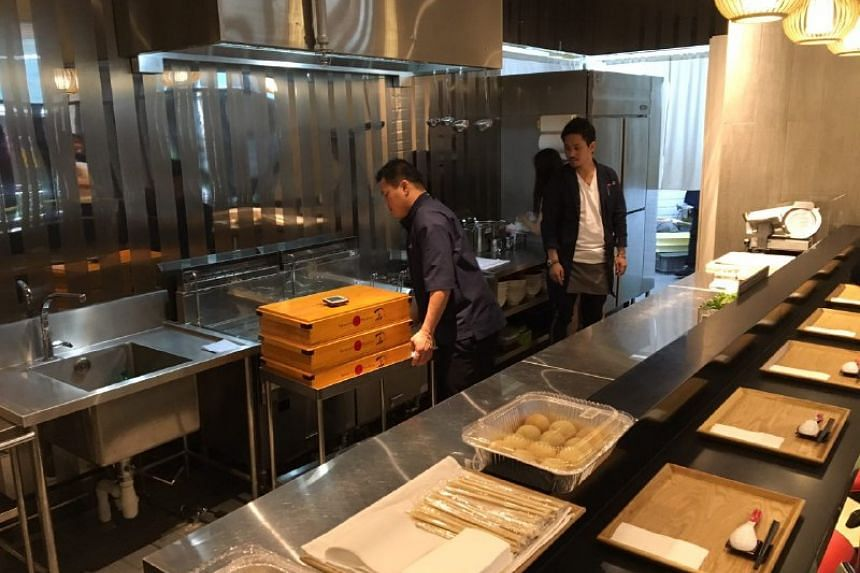 Chef  Yuki Onishi making final touches to the shop ahead of its 11am opening.