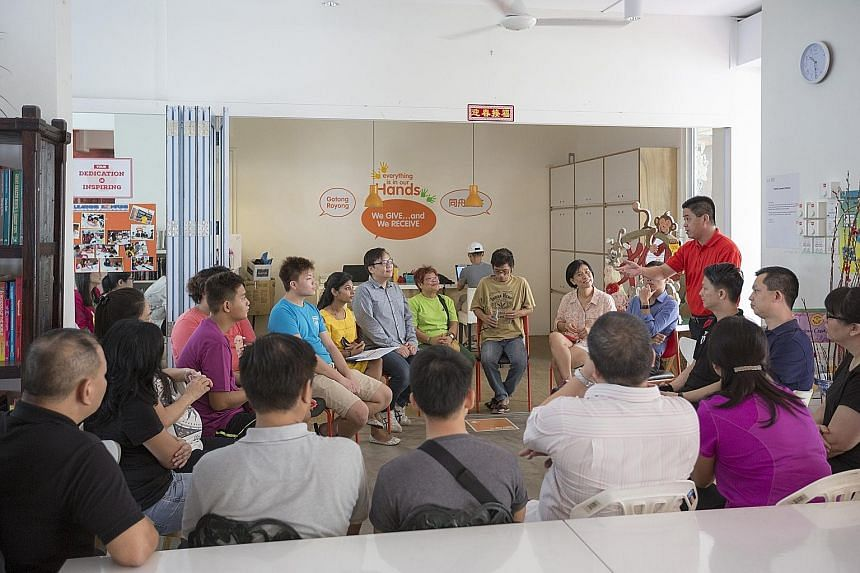 Mr Benny Ng (in red), general manager of operations at ABR Holdings' Swensen's, speaking to representatives of ABR and South Central Community Family Service Centre. The family service centre's staff learnt about safety at work and food handling prac