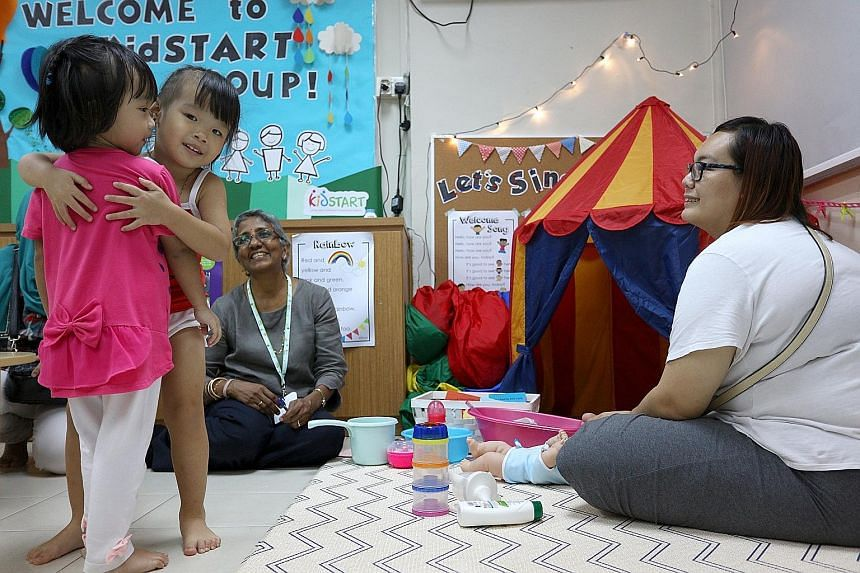 Three-year-old Kayley Ling (second from left) hugging a playmate, while her mother, Ms Cassandra Ling, 23, looks on during a playgroup session at the We Love Learning centre in Henderson. The sessions aim to boost parenting skills and improve parent-