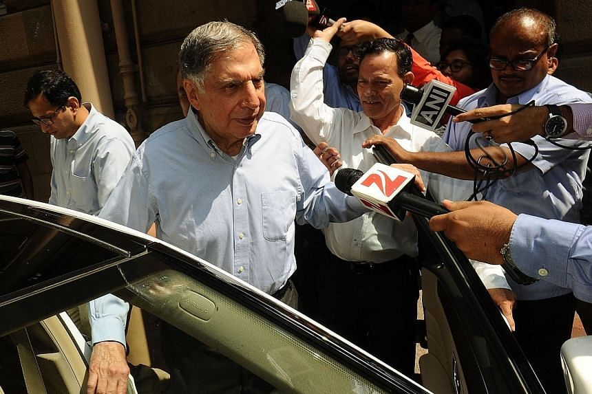 Tata Sons interim chairman Ratan Tata leaving Bombay House, the company's head office, in Mumbai. He has put together a new management team in the wake of Mr Cyrus Mistry's removal as chairman.