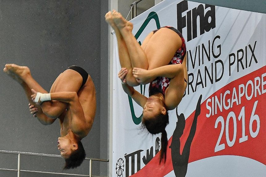 Above: Singapore's Joshua Chong and Ashlee Tan in action at the Fina Diving Grand Prix at the OCBC Aquatic Centre yesterday. The duo posted a score of 243.78 in the mixed synchronised 3m event, meeting the Singapore Swimming Association's qualifying