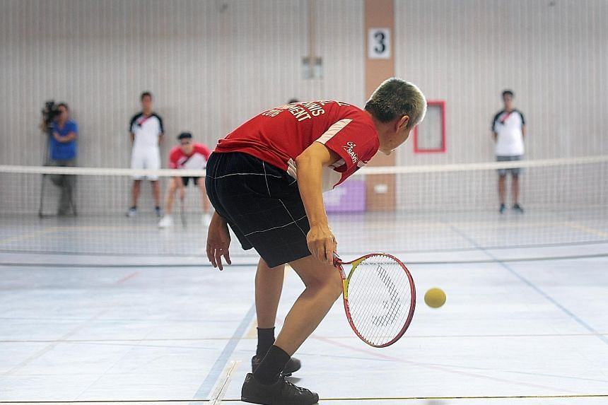 Hung Kee Seng about to return to Ong Hock Bee in the B1 final of the first National Soundball Tournament yesterday. Ong won 4-0. Players locate the ball by the rattling sound it makes.