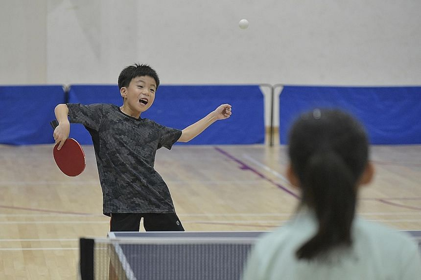 Eight-year-old Tang Yong Chian having a go at the Wang Yuegu Table Tennis Academy launch and open house.