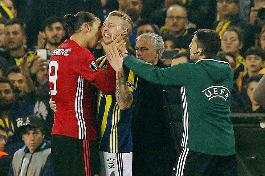 Zlatan Ibrahimovic grabs the throat of Fenerbahce's Simon Kjaer during a bust-up in their Europa League game that the Turkish side won 2-1. Manager Jose Mourinho has no issue with the Swede's contribution except in Thursday's match.