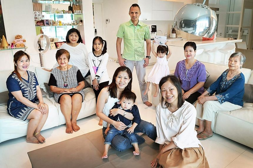 Madam Baraquel (second from left), flanked by her daughter Charity (left) and Madam Foo at the reunion last week with members of both families. Ms Jamie Lim is seated in the foreground with her one-year-old son, Jalen.