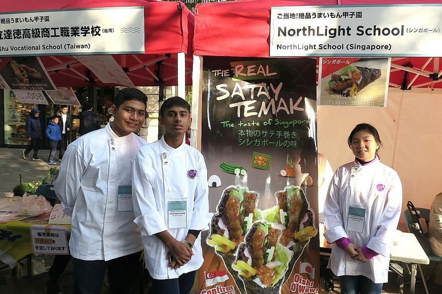 Northlight School students (from left) Firdaus, Amshyar and Li Lin at their booth in Tokyo yesterday. Their satay temaki dish is made by wrapping lettuce, egg, cucumber, onion, rice and satay chicken in seaweed and then dousing it in a piquant satay