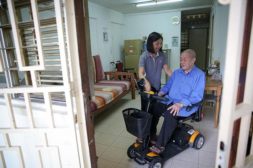 Mr Goh appreciates the help he gets from occupational therapist Doreen Ang, saying she is like family to him.