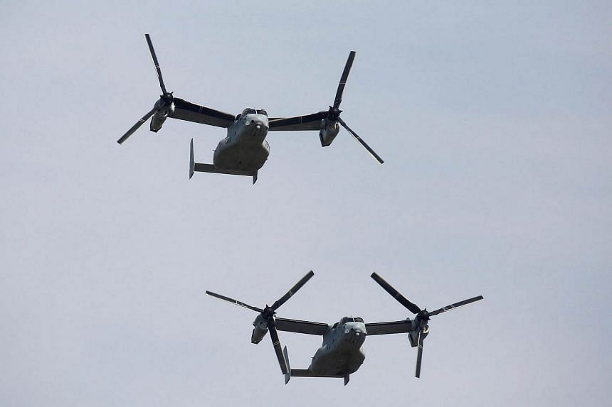 US Osprey aircraft fly in the annual ceremony of Japan's Self-Defence Forces at Asaka Base, Japan on Oct 23, 2016.
