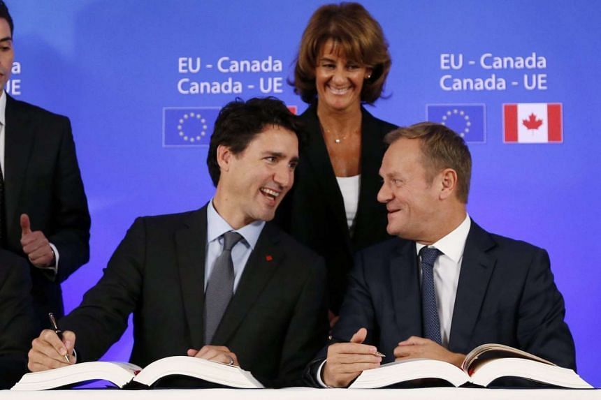 Canada's Prime Minister Justin Trudeau (left) and European Council President Donald Tusk at the EU-Canada summit during signing of the agreement on the Comprehensive Economic and Trade Agreement (CETA) in Brussels, Belgium on Oct 30.