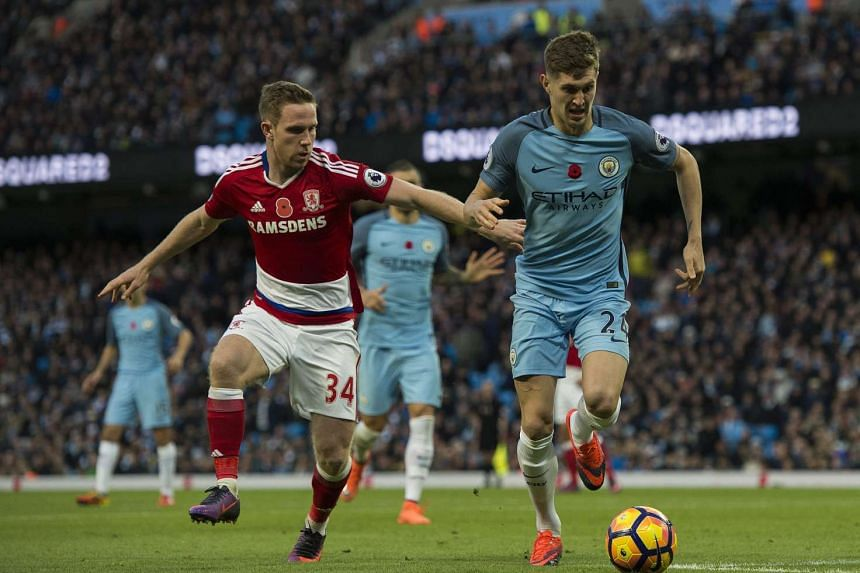 Middlesbrough's Adam Forshaw (left) in action with Manchester City's John Stones (right) during the English Premier League soccer match between Manchester City and Middlesbrough at The Etihad Stadium, Manchester.
