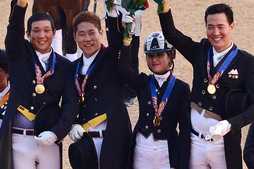 Ms Chung and her teammates receiving gold medals at the Asian Games in Incheon in 2014. She was admitted to the prestigious Ewha Womans University on the strength of the medal. Critics accused the university of giving her preferential treatment becau
