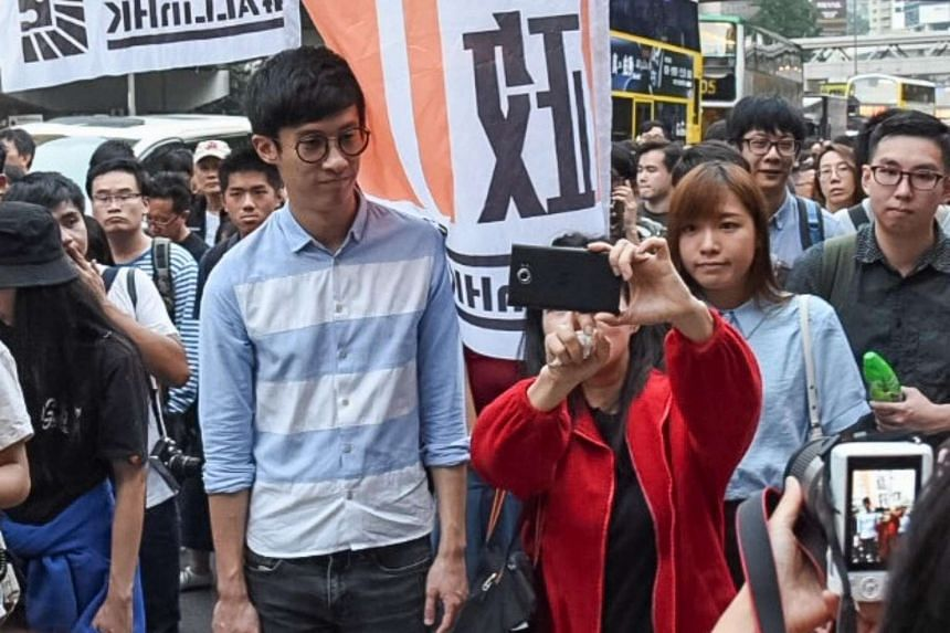 A protester taking a selfie with Hong Kong lawmakers Sixtus Leong (left) and Yau Wai Ching, who are both embroiled in the oath-taking row, during a demonstration on Nov 6, 2016.