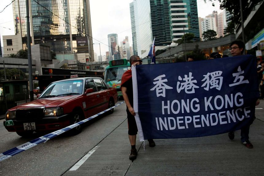 Demonstrators protest against what they say is Beijing's interference over local politics and the rule of law, in Hong Kong on Nov 6, 2016.
