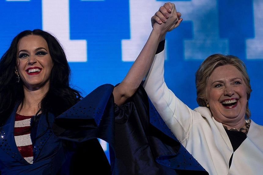 Katy Perry and Hillary Clinton cheer during a GOTV concert at the Mann Center for the Performing Arts on Nov 5, 2016 in Philadelphia, Pennsylvania.