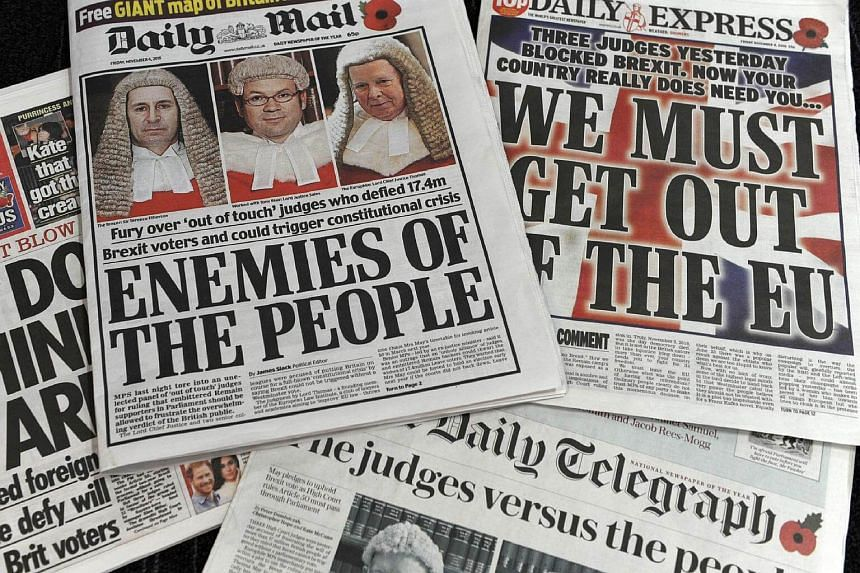 A selection of the front pages of British newspapers taken on November 4, 2016 following the High Court ruling yesterday that the Conservative government do not have the power on their own to trigger Article 50 of the Lisbon Treaty.