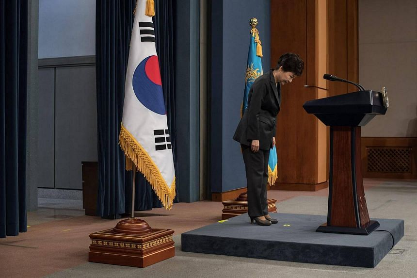 South Korean President Park Geun Hye bows prior to delivering an address to the nation.