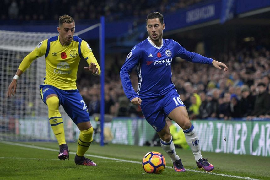 Chelsea's Eden Hazard (right) was the star of the night as his team pummelled Everton.