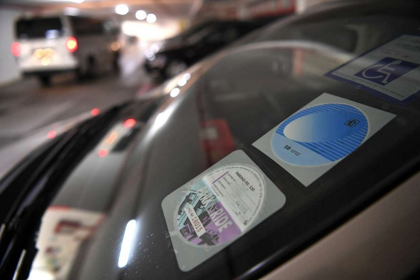 A Park and Ride disc displayed on the windshield of a car.