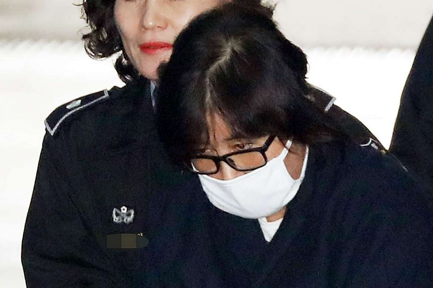 Choi Soon Sil is escorted into the Seoul Central District Prosecutor's Office in Seoul on Nov 3, 2016.