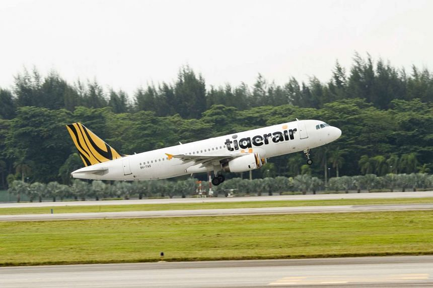 A Tigerair plane taking off.