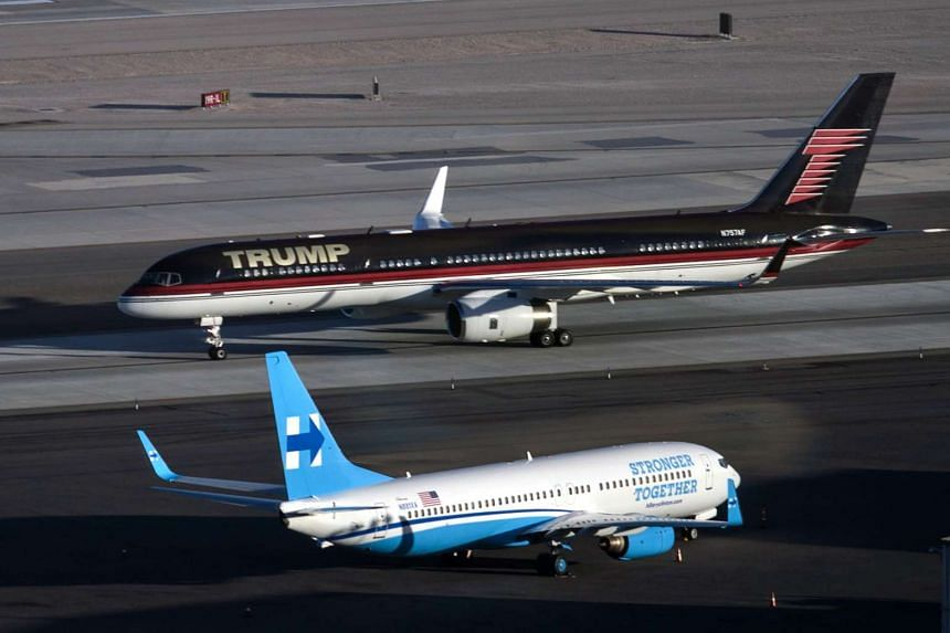 Republican presidential nominee Donald Trump's plane passes Democratic nominee Hillary Clinton's campaign plane at McCarran International Airport on Oct 18, 2016 in Las Vegas, Nevada, on the eve of the third and final US presidential debate.