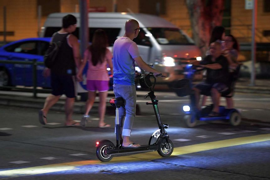 Generic photo of a man on an electric scooter crossing the road as he passes an elderly man on an electric wheelchair along Toa Payoh Lorong 1 on Oct 28, 2016.